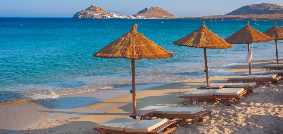 The sandy beach near the blue sea Mykonos